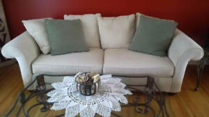 Upholstered ivory couch with cushions- DIY Home Reno