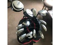 Golf clubs. Full set of irons and drivers, bag included