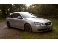 Subaru all wheel drive estate, silver, automatic with manual sports over ride.