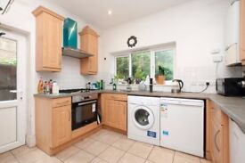 An exotic four bedroom, three storey modern house with a garden