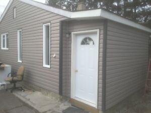 Hinton house for slale/rent with large treed lot and garage