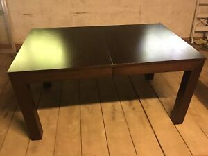Wooden dining room table with built in leaf