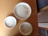 A Set of Dinner Plates, Side Plates and Bowsl