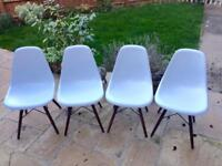 Set of four Eames-style dining chairs