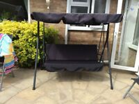 3 seater swinging garden seat.