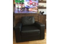 Modern black faux leather armchair from John lewis, like new, can come appart