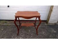 Edwardian Mahogany serpentine shaped 2 tier centre table on cabriole legs.