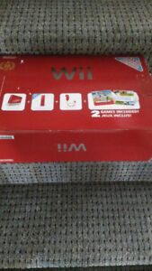 Red Wii with remote (games sold separate)