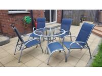 7 Pce patio Set with 4 reclining chairs, table and 2 foot rests