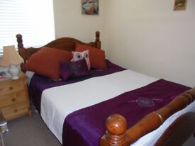 Used solid wood large double bed with memory foam matress for sale in Bangor.