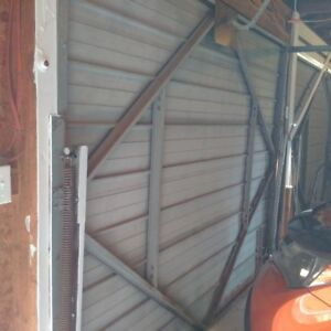 pair of Steel Garage Doors 9x7 with tracks and hardware