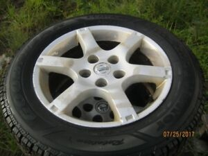 Good Year Ultra  Grip    215-60-16 winter tires on Nissan rims