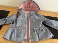 LOVLEY LITTLE GIRLS LINED RAIN COAT. 12/18 months