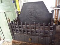 Ornamental cast iron fire back and grate