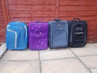 Suitcase's x 4. INCLUDES 3 LUGGAGE STRAPS