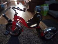 Childs trike bike, red black and silver in color, 3 wheels has a bell ....Excellent condition