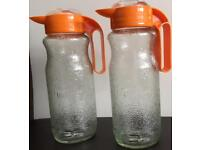 Two Collectable Sunquick Juice Glass Jugs