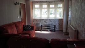 1 bedroom flat attached to a detached house
