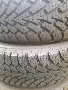 Like new!  2-P215/60R15 GOODYEAR NORDIC SNOW TIRES!