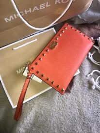 Jet set orange Michael Kors clutch bag.
