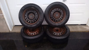 Set of four winter tires on rims