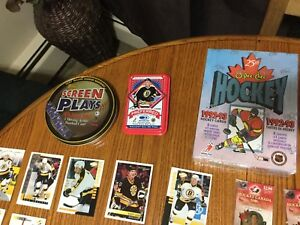 Old/new hockey cards/ collector Tin/ moving baseball card.