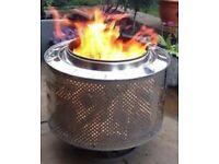 Washing machine drum fire pit/log burner on a stand