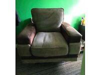Brown swivel cube chair