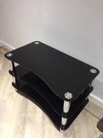 black glass/chrome tv stand