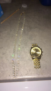 Gold plated necklace and watch. Price is negotiable.