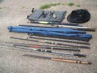 selection of fishing rods reels landig net