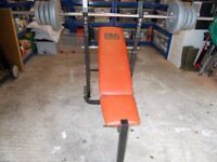 Pro Power Weight Bench and assorted weights.