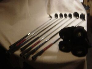 Assorted used Golf Clubs and Covers in Good Condition See Pics.