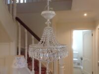 A pair of crystal chandeliers for sale .