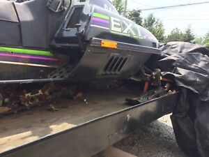 2 snowmobiles and double trailer