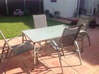 Glass and coated aluminium patio table with 4 matching adjustable chairs
