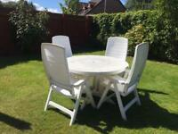 Garden furniture - round large table with 4 x reclining chairs and cushions