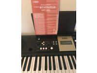 Yamaha digital keyboard and stand