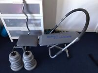 Weights bench with removable sit-up assist bar and weights bar with weights. £100 O.N.O