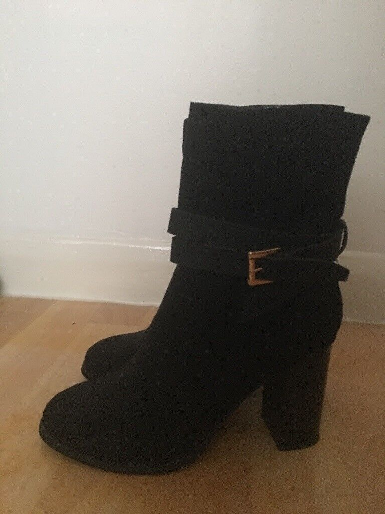 Womens black boots size 6in West Ealing, LondonGumtree - Black suede boots with elegant gold buckle size 6 worn once for about 10min dont wear them anymore thanks for looking