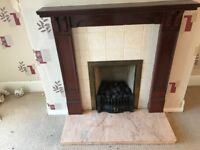 Hi I'm selling a gas fire place with marble bottom and wooden frame