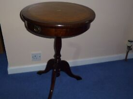 Circular Reproduction Wine Table with leather top and storage drawer.