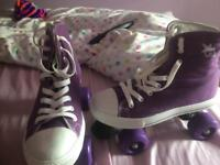 Girls four wheeled size four trainer roller skates
