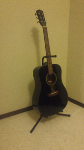 Black Acoustic Fender Guitar with Stand
