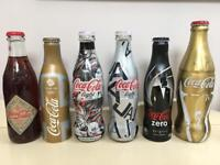 Collection of 18 limited edition Coca-Cola bottles