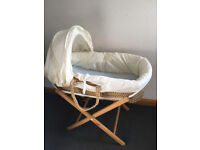 Moses basket with mattress, folding stand and sheets.