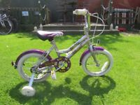 """GREAT GIRLS 14"""" WHEELED BIKE..PROFESSIONAL HONEYBEE,COMPLETE WITH STABLISERS. GREAT CONDITION."""