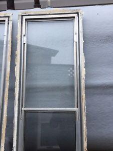 2 aluminum storm venting windows