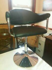 Black and chrome leather chair
