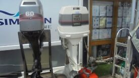 Johnson 150hp outboard motor, long shaft, electric start, power trim in excellent condition.